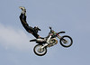 Ryan Hagy of San Clemente, California wows the Huntington Beach crowd with an incredible aerial display during the Freestyle Motocross event at the Bank of the West Beach Games on July 29, 2006.  Freestyle MX notables from around the world entertained attendees with aerial tricks performed while launching their dirtbikes over fifty feet above the crowd.