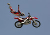 Myles Richmond of Cherry Valley, California wows the Huntington Beach crowd with an incredible aerial display during the Freestyle Motocross event at the Bank of the West Beach Games on July 29, 2006.  Freestyle MX notables from around the world entertained attendees with aerial tricks performed while launching their dirtbikes over fifty feet above the crowd.