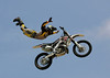 Mike Mason of Carson City, Nevada wows the Huntington Beach crowd with an incredible aerial display during the Freestyle Motocross event at the Bank of the West Beach Games on July 29, 2006.  Freestyle MX notables from around the world entertained attendees with aerial tricks performed while launching their dirtbikes over fifty feet above the crowd.