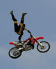 Graham Gustin of Costa Mesa, California wows the Huntington Beach crowd with an incredible aerial display during the Freestyle Motocross event at the Bank of the West Beach Games on July 29, 2006.  Freestyle MX notables from around the world entertained attendees with aerial tricks performed while launching their dirtbikes over fifty feet above the crowd.