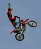 Cam Sinclair of Melbourne, Australia wows the Huntington Beach crowd with an incredible aerial display during the Freestyle Motocross event at the Bank of the West Beach Games on July 29, 2006.  Freestyle MX notables from around the world entertained attendees with aerial tricks performed while launching their dirtbikes over fifty feet above the crowd.