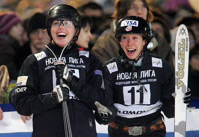 Deidra Dionne (left) of Canada and Emily Cook of the United States check the results as Dionne finished second and Cook was first in aerials at a FIS freestyle World Cup at Moscow State University in Moscow, Saturday, March 1, 2008.  Photo by Mike Ridewood/GIS