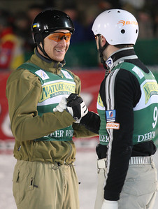 Stanislav Kravchuk (left) of Ukraine is congratulated on his win by second place Vladimir Lebedev of Russia in aerials at a FIS freestyle World Cup at Deer Valley Resort in Park City, Utah, Friday, Feb. 1, 2008.   Photo by Mike Ridewood/FIS