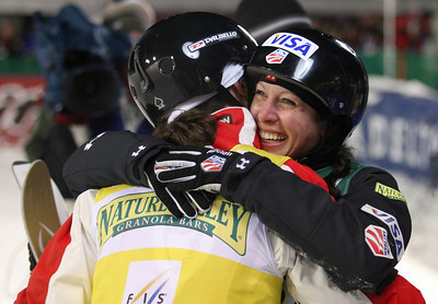 Emily Cook (right) of the United States congratulates Jacqui Cooper of Australia on her second place in aerials at a FIS freestyle World Cup at Deer Valley Resort in Park City, Utah, Friday, Feb. 1, 2008.   Photo by Mike Ridewood/FIS