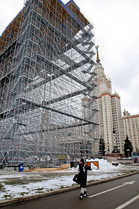 Warren Shouldice of Canada walks past the rear of the scaffold structure of the aerials site for a FIS freestyle World Cup at Moscow State University in Moscow, Saturday, Mar. 1, 2008. Photo by Mike Ridewood/FIS