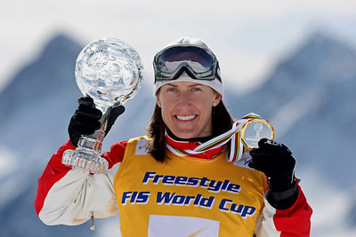 Jacqui Cooper of Australia with the FIS aerials World Cup overall globes and medal in Davos,  Switzerland, Thursday, Mar. 6, 2008. Photo by Mike Ridewood/FIS