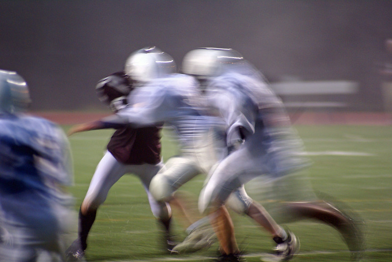 Josh (73) and team look good with the blur , rainy effect.  They were handed their first and only loss in '07 this night.  Frames 10-13 are my favorite.