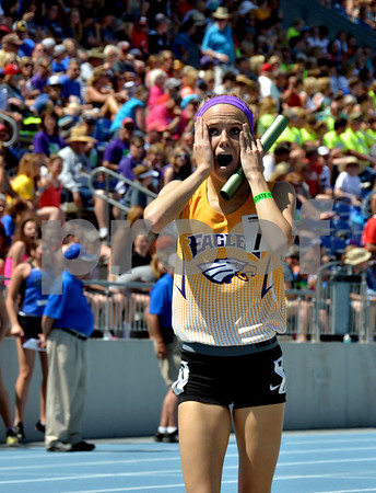 -Messenger photo by Britt Kudla<br /> Tiffany Christensen of Eagle Grove is shocked as she comes from behind in the 2A Distance Medley Relay final on Friday