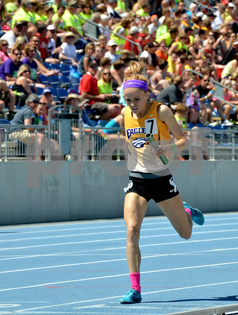 -Messenger photo by Britt Kudla<br /> Tiffany Christensen of Eagle Grove comes from behind to finish second in Class 2A Distance Medley Relay on Friday at Drake Stadium