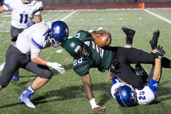 Muskogee Roughers hosting the Sapulpa Chieftains.  September 26, 2014 - Muskogee, OK. <br /> <br /> Jacouri Freeman tackled by \s25\ and assisted by \74\