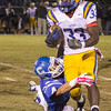 Checotah Wildcats hosting the Victory Conquerors.   October 3, 2014 - Checotah, OK. Ogle Field.  Conqueror #33.  Checotah Wildcat #4 Cody Cox