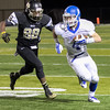 Wildcat Cody Cox is chased byBeggs Demon Kenny Kennedy #88