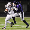 Globe/Roger Nomer<br /> Pittsburg's Sherrick Rogers tackles Blue Valley Southwest's Sam Randall during Friday's game.