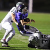 Globe/Roger Nomer<br /> Pittsburg's Riley Cunningham is brought down by Blue Valley Southwest's Ryan Peroo (3) and Trevor Scheumann (36) during Friday's game.