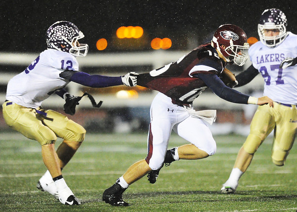Joplin quarterback Skyler Duley attempts to get away from the tug of Camdenton's Kullen Carlock Friday night, Oct. 18, 2013, at Joplin's Junge Stadium.<br /> Globe | T. Rob Brown