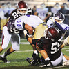 Joplin defenders Josh Miller (80) and Phillip Reitz (55) bring down Camdenton fullback Matt Endsley Friday night, Oct. 18, 2013, at Joplin's Junge Stadium.<br /> Globe | T. Rob Brown