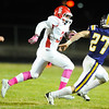 Carl Junction's Keynan Scheurich looks to the path ahead as Monett's Cameron Witt looks for the defensive play Friday night, Oct. 25, 2013, at Monett's Burl Fowler Stadium.<br /> Globe | T. Rob Brown