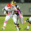 Carl Junction's Tanner McMurtrey gets brought down by Monett's Aaron Aldrich Friday night, Oct. 25, 2013, at Monett's Burl Fowler Stadium.<br /> Globe | T. Rob Brown