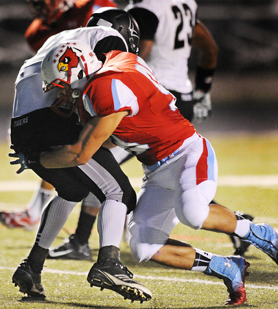 Webb City's Easton Carver brings down Willard wide receiver Jordan Powell during Friday night's game, Oct. 4, 2013, at Webb City's field.<br /> Globe   T. Rob Brown