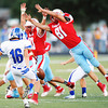 Webb City's Alex Lane leaps into the path of Carthage punter Tom Simmons Friday night, Sept. 13, 2013, at Webb City's field.<br /> Globe | T. Rob Brown
