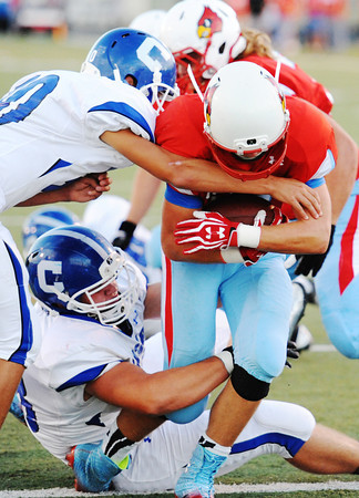 Webb City's Kyle Baldassarre brings the ball over the goal line despite the Carthage defense including Alex Derrberry (10, left) Friday night, Sept. 13, 2013, at Webb City's field.<br /> Globe   T. Rob Brown
