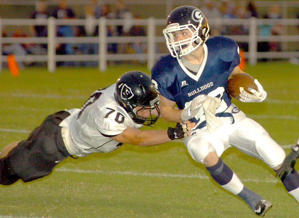 Laurie Sisk/Globe<br /> Frontenac's Nathan Hemby tries to bring down Galena's Logan Johnson during the first half of their game on Friday night at Galena.