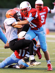 Globe/Roger Nomer Webb City's Kolesen Crane (21) and Cameron Tournear tackle Republic's Tryston Ellison during Friday's game in Webb City.