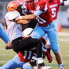 Globe/Roger Nomer<br /> Webb City's Kolesen Crane (21) and Cameron Tournear tackle Republic's Tryston Ellison during Friday's game in Webb City.