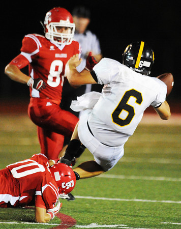 Carl Junction's Christian Pittman brings down Cassville quarterback Gabe Kirk during Friday night's game, Sept. 27, 2013, at Carl Junction's field.<br /> Globe | T. Rob Brown