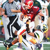Joplin runningback Adam Norsworthy pulls against the pull of a Parkview defender Friday evening, Sept. 6, 2013, at Joplin's field.<br /> Globe | T. Rob Brown