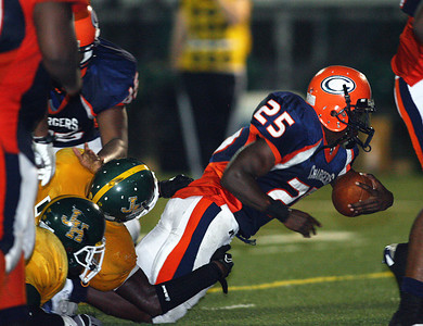Callaway running back Daryl Jones, Jr. is tackled by a host of Jim Hill defenders.