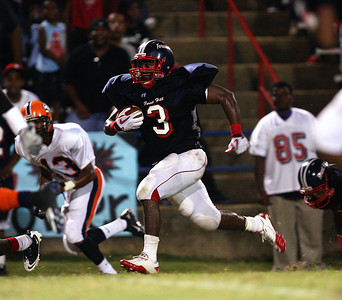 Forest Hill running back Jabari Baker runs past a host of Callaway defenders.