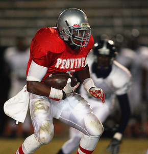 Provine running back Jadarius Hicks scampers for yardage during the first half.