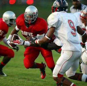 Provine's Jadarius Hicks attempts to break a tackle against Forest Hill defenders.