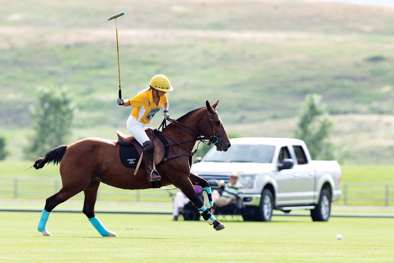 Matthew Gaston | The Sheridan Press<br>Stacie Beckman loads up to knock the ball on during the second chukker of the evening at the Big Horn Equestrian Center Friday, July 26, 2019.