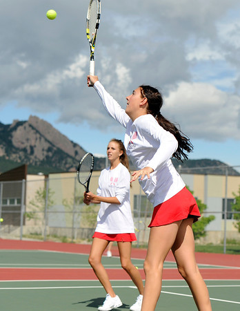 """Fairview High School's Megan Thayer, left, and Paris Hogan during a semi-final doubles match against Poudre High School in the Front Range League Tennis Championships at Fairview High School. For more photos of the matches go to  <a href=""""http://www.dailycamera.com"""">http://www.dailycamera.com</a><br /> Jeremy Papasso/ Boulder Daily Camera"""