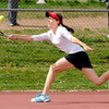 "Fairview High School's Katie Kuosman returns the ball to Fossil Ridge's Andrea Motley during a semi-final match in the Front Range League Tennis Championships at Fairview High School. For more photos of the matches go to  <a href=""http://www.dailycamera.com"">http://www.dailycamera.com</a><br /> Jeremy Papasso/ Boulder Daily Camera"