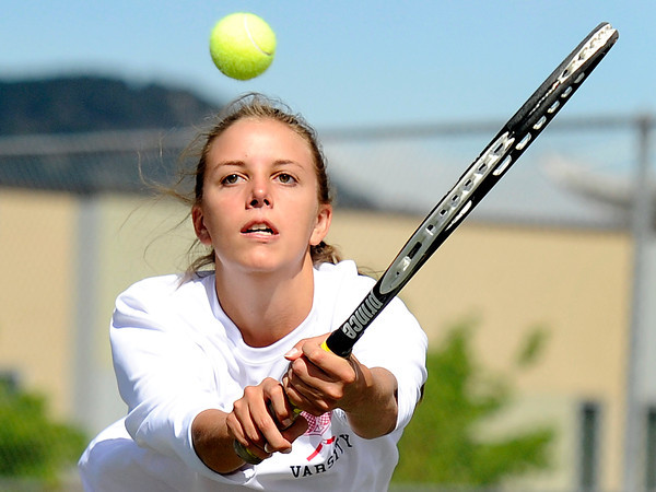 "Fairview High School's Megan Thayer returns the ball during a semi-final doubles match against Poudre High School in the Front Range League Tennis Championships at Fairview High School. For more photos of the matches go to  <a href=""http://www.dailycamera.com"">http://www.dailycamera.com</a><br /> Jeremy Papasso/ Boulder Daily Camera"