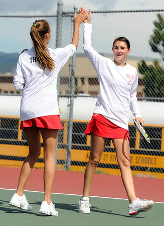 "Fairview High School's Megan Thayer, left, and teammate Paris Hogan high-five each other after scoring against Poudre High School's Rachel Lieurance and Brook Santangelo during a semi-final doubles match in the Front Range League Tennis Championships at Fairview High School. For more photos of the matches go to  <a href=""http://www.dailycamera.com"">http://www.dailycamera.com</a><br /> Jeremy Papasso/ Boulder Daily Camera"