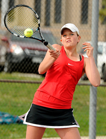 "Loveland High School's Jennifer Weissmann returns the ball during a semi-final match against Rocky Mountain High School's Cara Cromwell in the Front Range League Tennis Championships at Fairview High School. For more photos of the matches go to  <a href=""http://www.dailycamera.com"">http://www.dailycamera.com</a><br /> Jeremy Papasso/ Boulder Daily Camera"