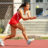 "Fairview High School's Monica Li returns the ball to Boulder High School's Miquela Newhart during a semi-final match in the Front Range League Tennis Championships at Fairview High School. For more photos of the matches go to  <a href=""http://www.dailycamera.com"">http://www.dailycamera.com</a><br /> Jeremy Papasso/ Boulder Daily Camera"