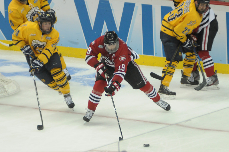 Drew LeBlanc reaches out for the puck.