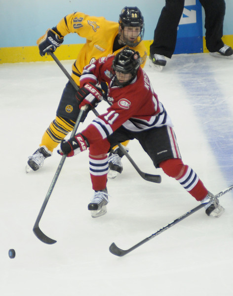 Kalle Kossila drives around Quinnipiac defenders.