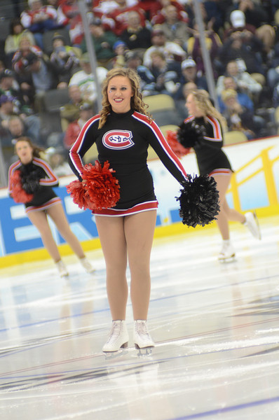 Cheer Team members take the ice.