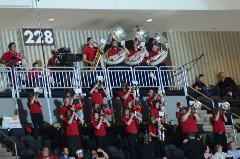 The Husky Sports Band plays.