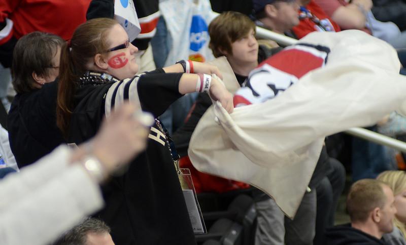 Husky fans cheer.