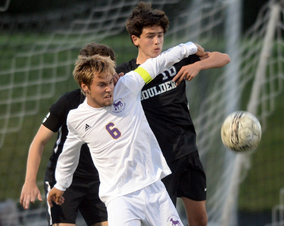 . BOULDER, CO - SEPTEMBER 13: Alec Fronapfel, left, of Ft Collins, keeps Kenneth Jew away from the ball. Boulder High played Ft Collins High at Recht Field on Thursday. (Photo by Cliff Grassmick/Staff Photographer)