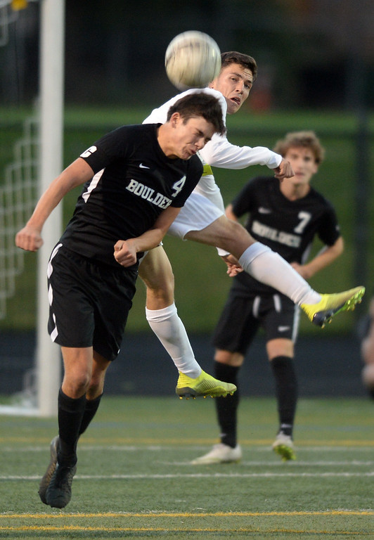 . BOULDER, CO - SEPTEMBER 13: Ian McDiarmid-Sterling, of Boulder, goes up against Anthony Priest, of Ft Collins. Boulder High played Ft Collins High at Recht Field on Thursday. (Photo by Cliff Grassmick/Staff Photographer)