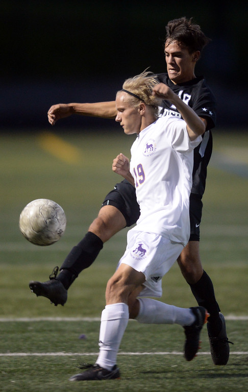 . BOULDER, CO - SEPTEMBER 13: Jack Chunko, left, of Ft Collins and Fabian Valencia, of Boulder, battle for the ball. Boulder High played Ft Collins High at Recht Field on Thursday. (Photo by Cliff Grassmick/Staff Photographer)