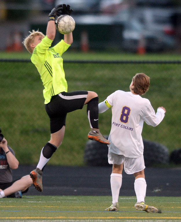 . BOULDER, CO - SEPTEMBER 13: Keeper, Tony Bateman, of Boulder gets to the ball in front of Jake Ratemacher, of Ft Collins. Boulder High played Ft Collins High at Recht Field on Thursday. (Photo by Cliff Grassmick/Staff Photographer)